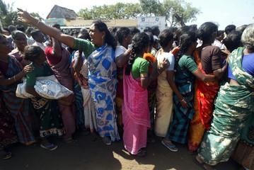 Indian tsunami survivors wait in queue to receive daily relief provisions in Cuddalore.