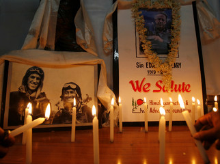 Mountaineers from HNAF light candles to pay their respect in front of a portrait of Hillary in Siliguri