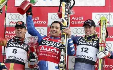 Winners of the Alpine skiing men's World Cup slalom celebrate while up on the podium in Kranjska Gora