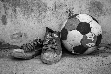 Old football and shoes.