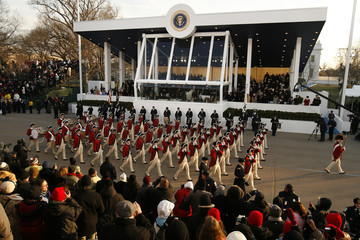 Red Coats marching band pass viewing stands during parade in honor of U.S. President Barack Obama in Washington