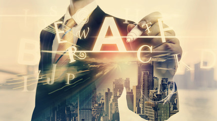 Alphabets with double exposure of businessman