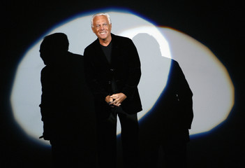 Italian designer Armani acknowledges applause at end of Emporio Armani's Fall/Winter 2007/08 men's collection during Milan Fashion Week