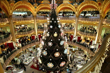 A giant christmas tree stands in the middle of Galeries Lafayette department store as the French cap..