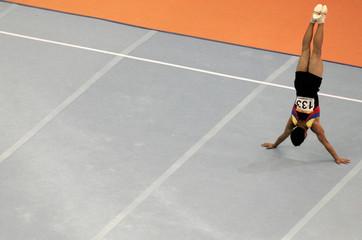 Saavedra of Ecuador performs in floor exercise portion of men's team gymnastics competition at Pan American Games in Rio de Janeiro