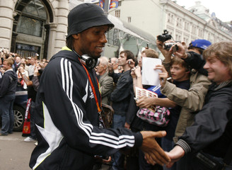 Didier Drogba of Chelsea greets supporters as he leaves from a hotel for training in Moscow