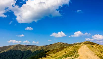 beautiful sky over the path through mountain ridge in summer