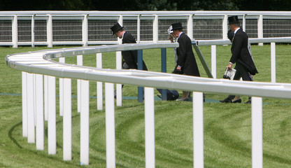 Race-goers arrive for the second day of racing at the Royal Ascot meeting