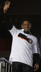 US actor Smith wears a jersey of the German national soccer team as he waves to the audience during the German premiere of his latest movie 'Hancock' in Berlin