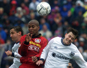 GORA AND MAIER OF SSV ULM HEAD FOR THE BALL WITH ROBERTO FROM BAYER 04 LEVERKUSEN.