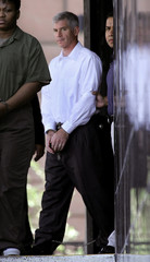 Former Enron CFO Andrew Fastow is taken by a U.S. Marshall in handcuffs and leg irons in Houston