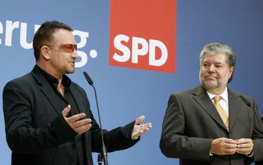 Beck, chairman of the German SPD and Bono, Irish lead singer of the band U2 address the media in Berlin