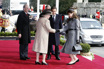Britain's Queen Elizabeth greets France's first lady Carla Bruni as Prince Philip and France's President Nicolas Sarkozy stand near during ceremonies at Windsor