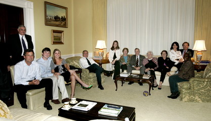U.S. President George W. Bush (5th L) gathers with members of his family in the West Sitting Hall of..