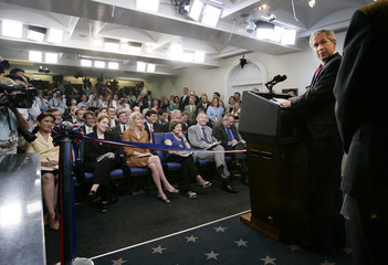U.S. President Bush officially opens the remodeled Brady Press Briefing room at the White House in Washington