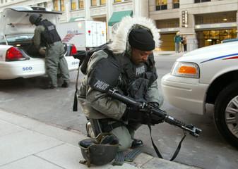 Police officer readies his weapon responding to man threatening to explode van near White House.