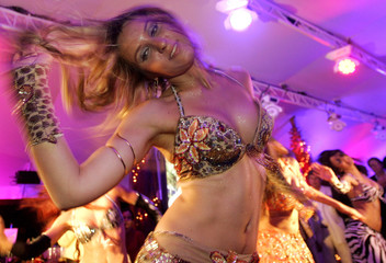 A belly dancer performs at the Dubai International Film Festival party in Cannes