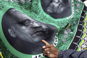 A supporter of ANC Deputy President Zuma points a his picture during the third day of the ANC conference in Polokwane