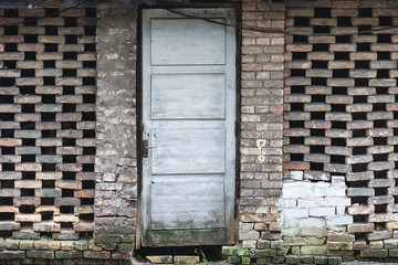 old barn brick wall and wooden door