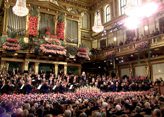MAESTRO NIKOLAUS HARNONCOURT CONDUCTS THE AUDIENCE DURING THE ANNUAL NEW YEARS CONCERT IN VIENNA.