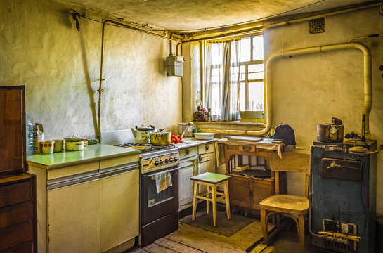 Dirty dark kitchen in an old beggar's house. A grim abstract scene about poverty and housing problems.