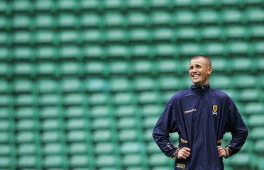 Scotland's Kenny Miller laughs during training session at Celtic Park in Glasgow