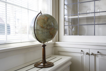 Model of globe near a window in the house