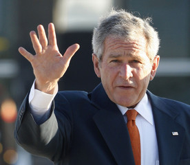U.S. President Bush waves to the media as he prepares to board Air Force One at Andrews Air Force Base near Washington