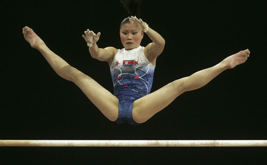 Pyon of North Korea competes on the uneven bars during gymnastics women's team event at the Asian Games in Doha