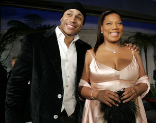 Cast member LL Cool J and co-star Queen Latifah pose at the premiere of Last Holiday in Los Angeles