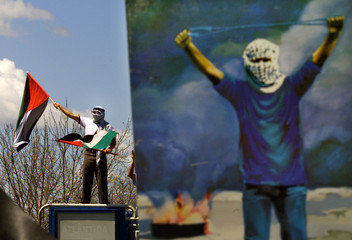 DEMONSTRATOR WAVES PALESTINIAN FLAGS AT PROTEST IN FRONT OF ISRAELIEMBASSY IN BRAZIL.