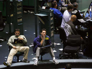 Traders work in the crude oil futures pit of the New York Mercantile Exchange in New York