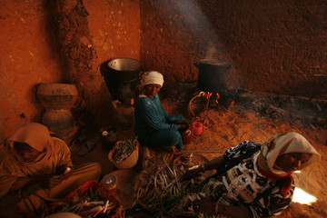Women cook at Massin Ksar, a fortified village on the outskirts of the oasis town of Timimoun