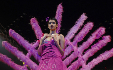 A model presents a creation during a fashion show in Hyderabad