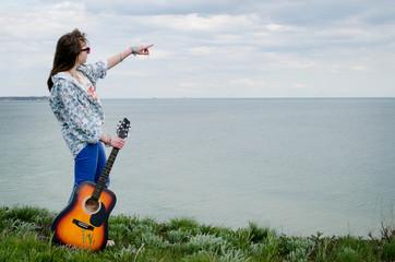 Hippie with guitar beach