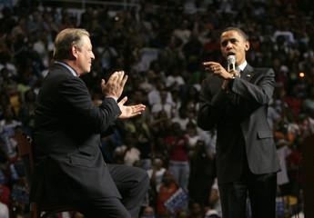 Senator Obama speaks as former U.S. Vice President Gore applauds during a campaign stop at Joe Louis Arena in Detroit Michigan