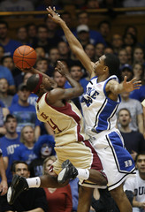 Boston College's Tyrese Rice goes to the basket against Duke University's Lance Thomas in Durham