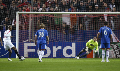Sevilla's Kanoute takes a penalty against Rangers' AMcGregor during their Champions League soccer match in Seville