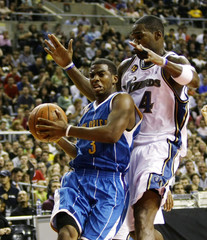New Orleans Hornets Chris Paul drives to the basket against Washington Wizards Antawn Jamison during the NBA Europe Live 2008 Tour at Palau Sant Jordi in Barcelona