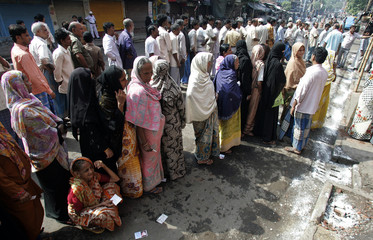 Voters stand in a queue to cast their ballots at a polling station in Kolkata