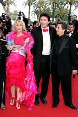 FRENCH ACTORS CHAZEL, PALMADE, AND CLAVIER POSE ON RED CARPET AT 57TH CANNES FILM FESTIVAL.