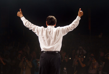 German Chancellor Schroeder gestures to his supporters after his speech at an election campaign ...