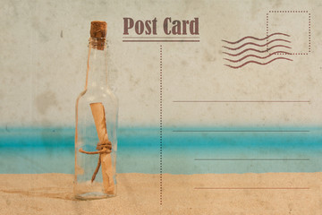 Vintage summer postcard. Message in the bottle on the beach