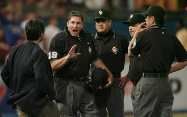 Umpires summon interpreter to discuss hit by Team Venezuela's Hernandez in seventh inning of play against Team Puerto Rico during their second round game in World Baseball Classic in Miami