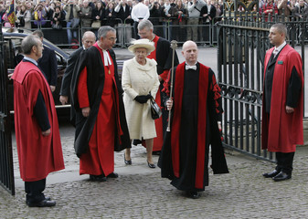 Britain's Queen Elizabeth arrives with Prince Philip to give her Commonwealth Day message at Westminster Abbey in London