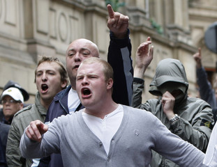 Men shout during a demonstration by the English Defence League in Birmingham