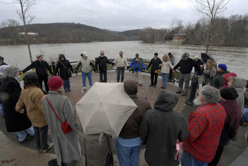 People pray during a Peace Vigil at Confluence Park in Binghamton New York