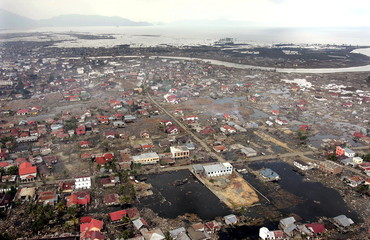 An aerial view shows the tsunami-devastated city of Banda Aceh on the Indonesian island of Sumatra J..