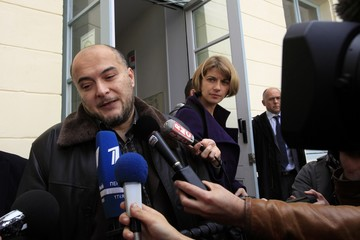 Kocacurt, father of Enis, attends the opening of the trial of accused Evrard at the courthouse of Douai
