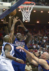 SIXERS HILL DRIVES TO THE BASKET.
